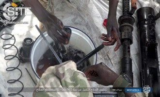 IS' West Africa Province Photographs Process of Cleaning Heavy Machine Gun, Loading Bullets