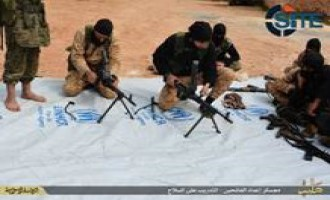 IS Publishes Photo Report on Training Camp in Aleppo, Fighters Using UNHCR Tarp as Surface to Prepare Guns