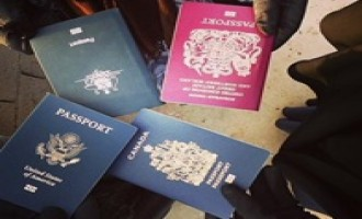 Female Jihadist Posts Pictures of American, British, Canadian, Australian Passports to be Burned