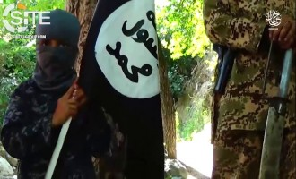 In IS Khorasan Province Video, Orphaned Child Stands Atop Decapitated Head and Threatens Revenge Against Spies