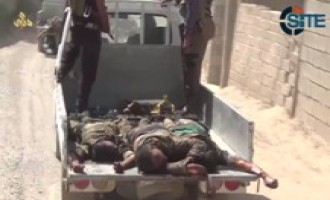 IS Video Shows Fighters Parading Dead Bodies of Shi'ite Militiamen Down Road in Diyala